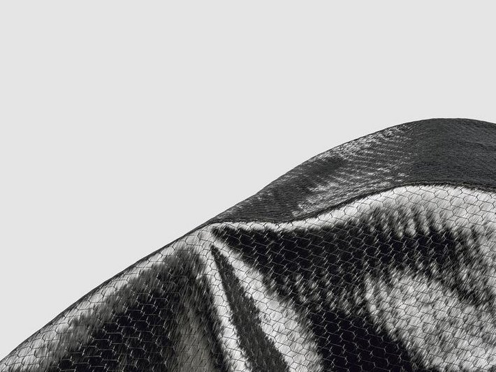 SIGRATEX<sup>®</sup> carbon fiber non-crimp fabric with a hexagonal visual pattern for design applications