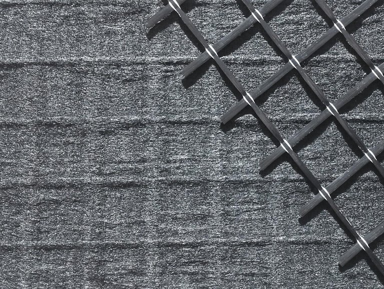 Nonwoven reinforced with carbon fiber grid
