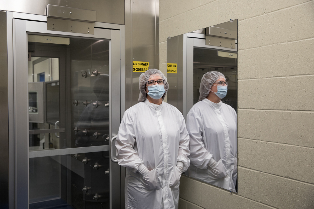 Prior to entering the clean room, all employees dress in protective clothing and pass through the air shower to remove containments.